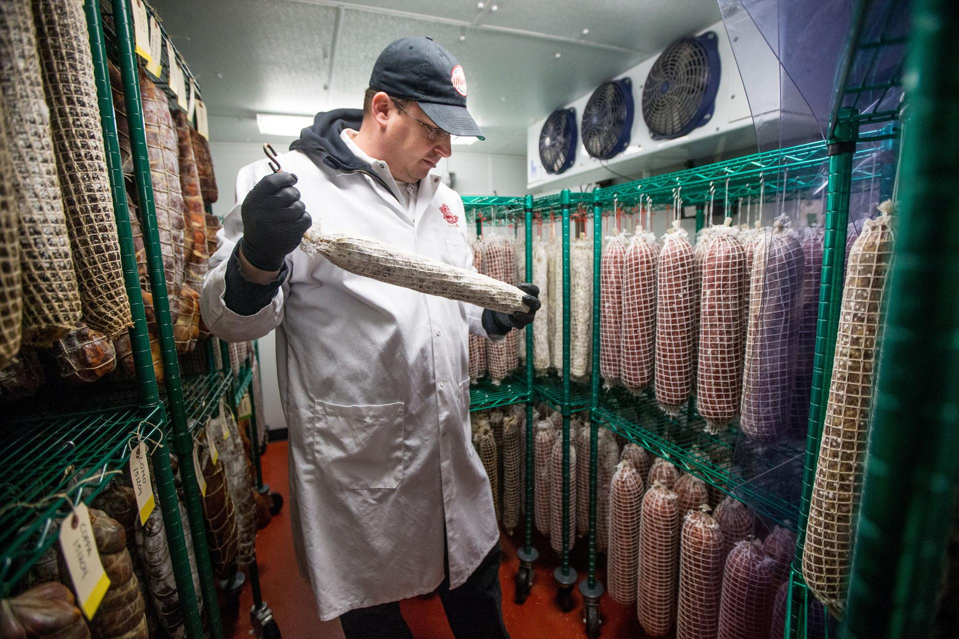 joshua smith is building charcuterie empire one link at a time joshua smith hanging cured meats at his waltham shop